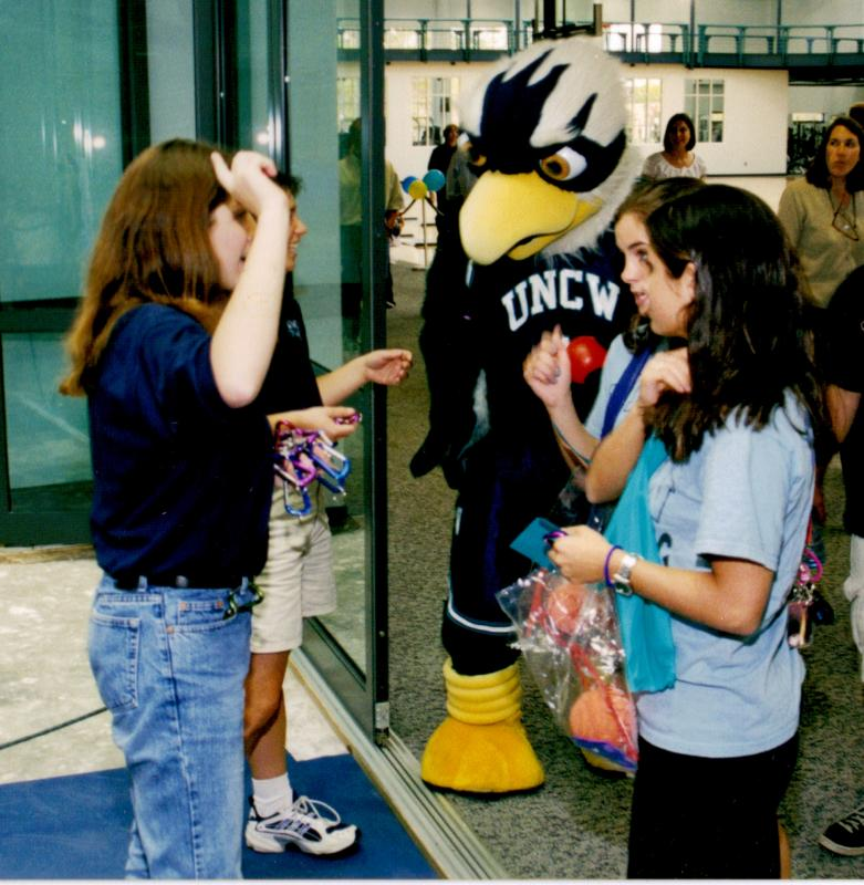 Photo from the University Archives: Seahawk mascot greets guests inside SRC