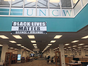A BLM banner hanging inside Randall Library